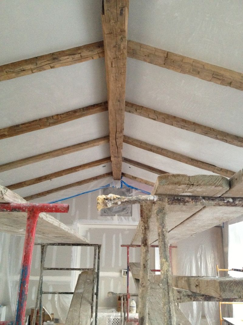 before pics of #PatinaFarm with wood beams on ceiling in great room