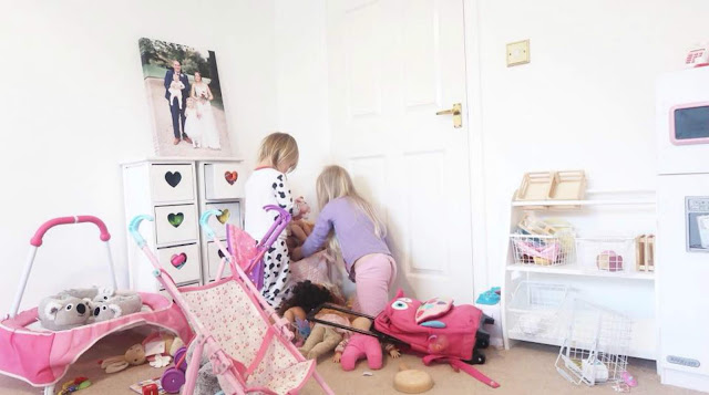 Children Playing in an Untidy Playroom