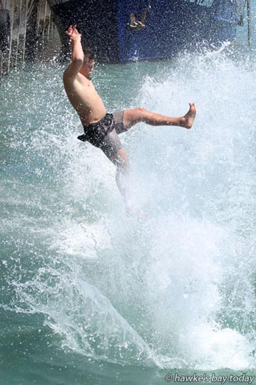 Stewart Cruden, 16, Palmerston North, jumping into Napier Inner Harbour, off West Quay, Napier, after four off his mates make a splash, in hot, sunny, summer weather. photograph