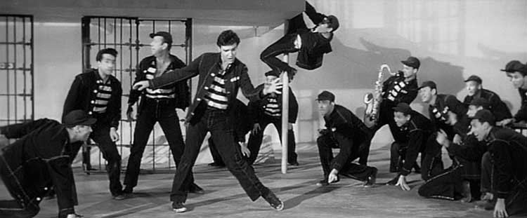 Elvis Presley gives his famous performance of the title song in Jailhouse Rock.