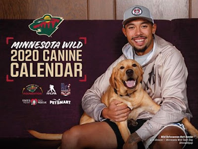 Minnesota Wild 2020 Canine Calendar, with a photo of player holding a dog