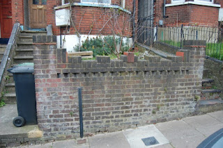 Old front garden retaining wall