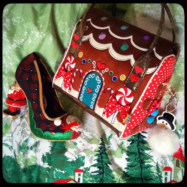 flatlay Lindy Bop Gilda dress print, Irregular Choice light up shoe and festive handbag with snowman pom pom keyring