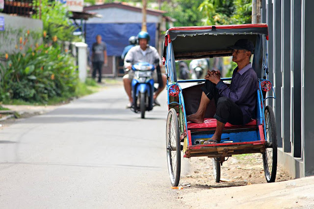Becak Driver Waiting For Passenger