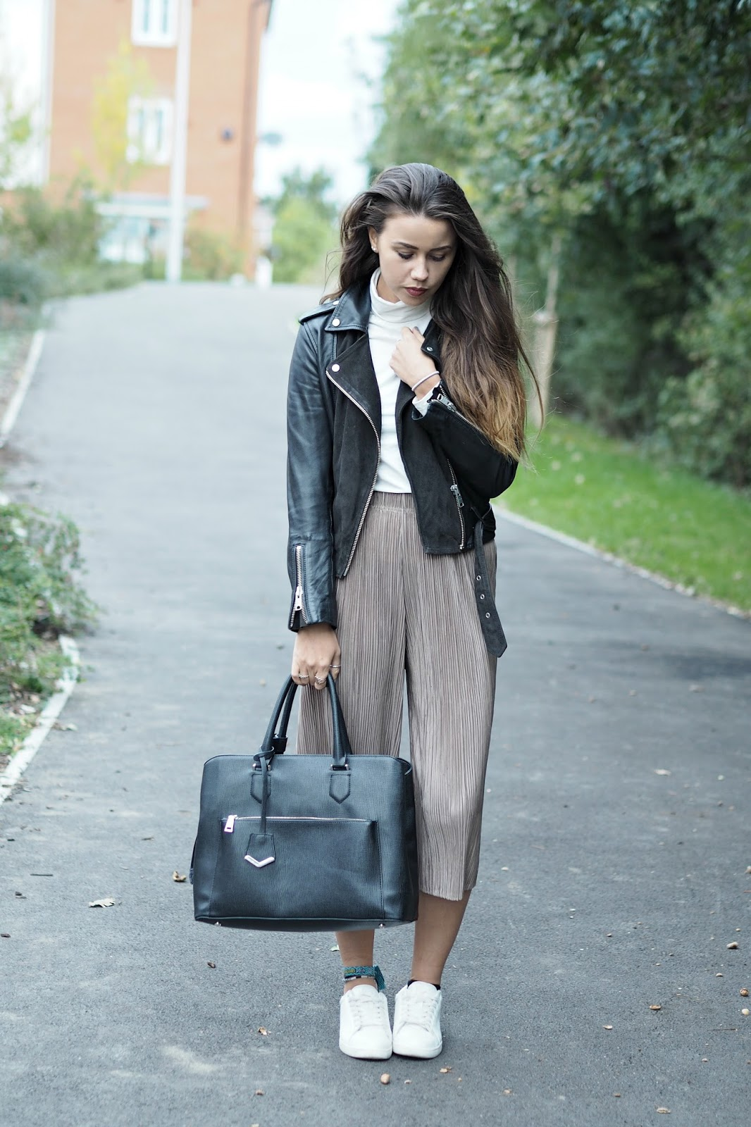 neutral outfit with pleated trousers