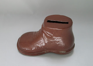 Side View of sheffield  pottery shoe bank  color brown