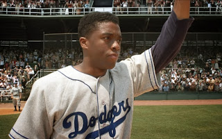 Chadwick Boseman as Jackie Robinson in 42