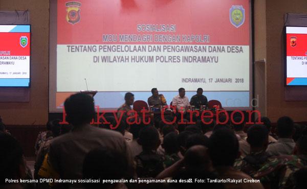 polisi sosialisasi  pengawalan dan pengamanan dana desa