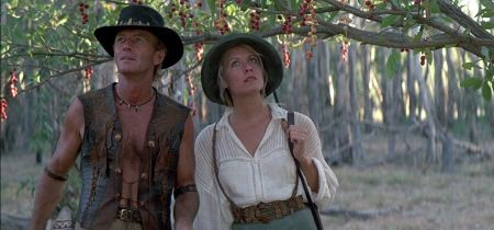 Paul Hogan and Linda Kozlowski among fruit trees