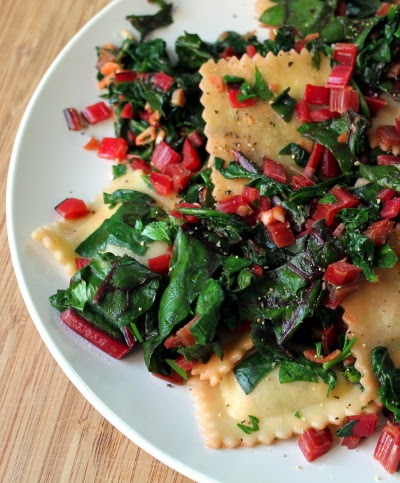 ravioli with garlic-sauteed chard and beet greens