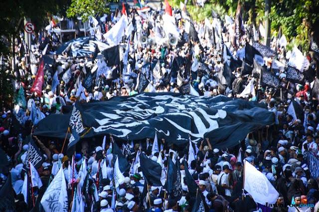 Banser Tantang Gelar Aksi Bela Bendera Bertuliskan Tauhid di Arab Saudi