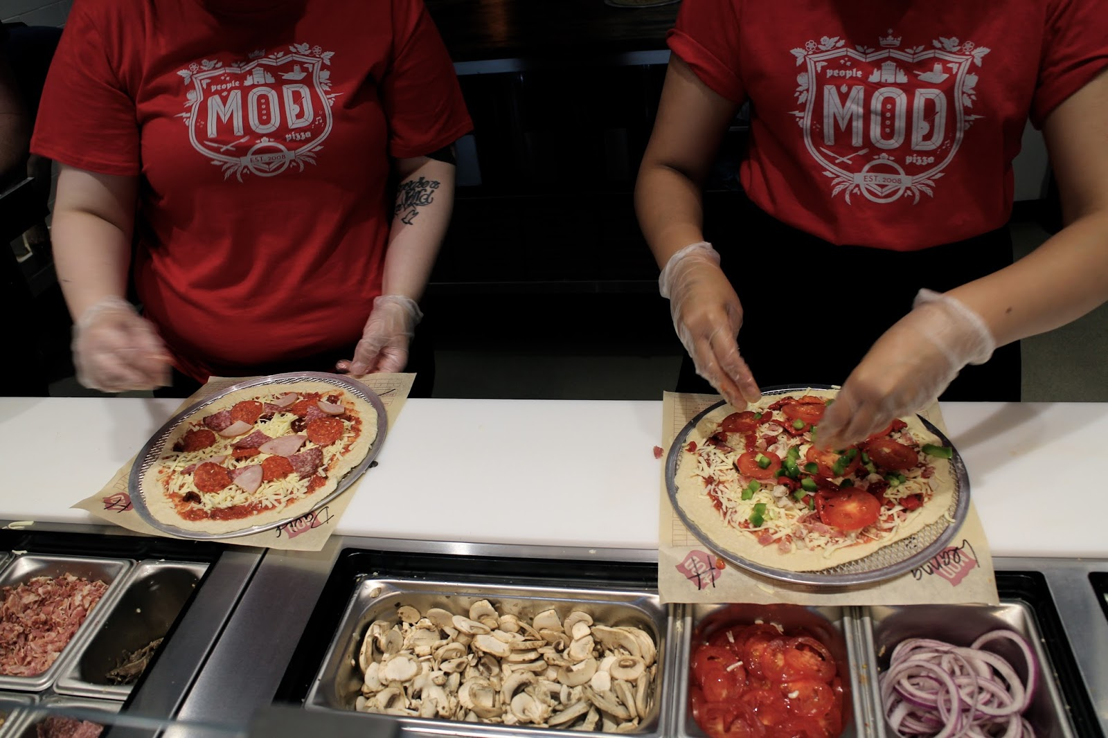 Making a pizza at MOD Leeds