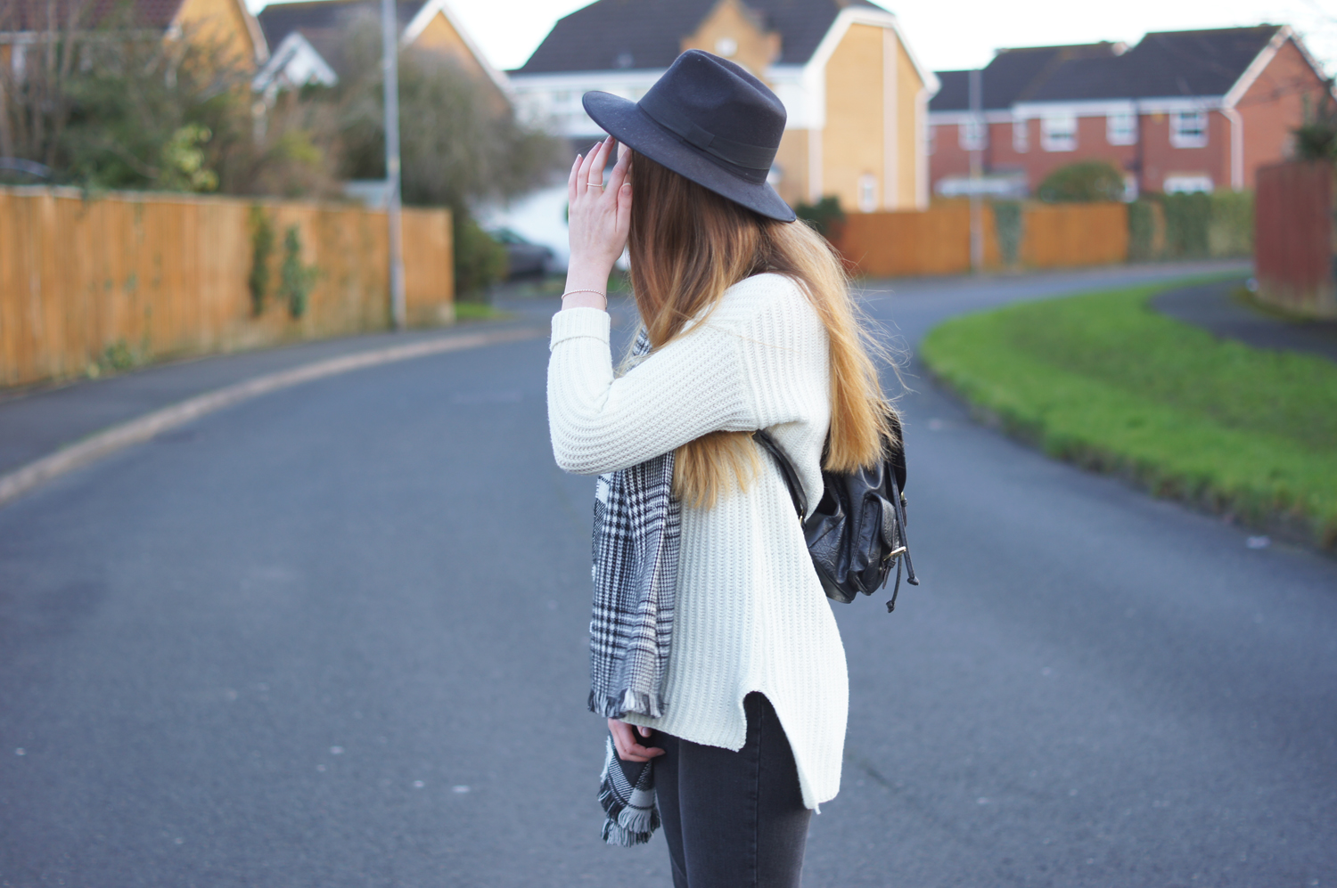 boohoo black fedora and cream jumper
