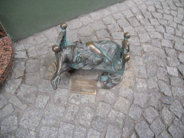 Gnome hunting in Wrocław Poland: Dwarf in a tiny bed