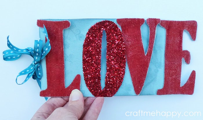 http://www.craftmehappy.com/2014/02/mini-valentines-love-album-template.html