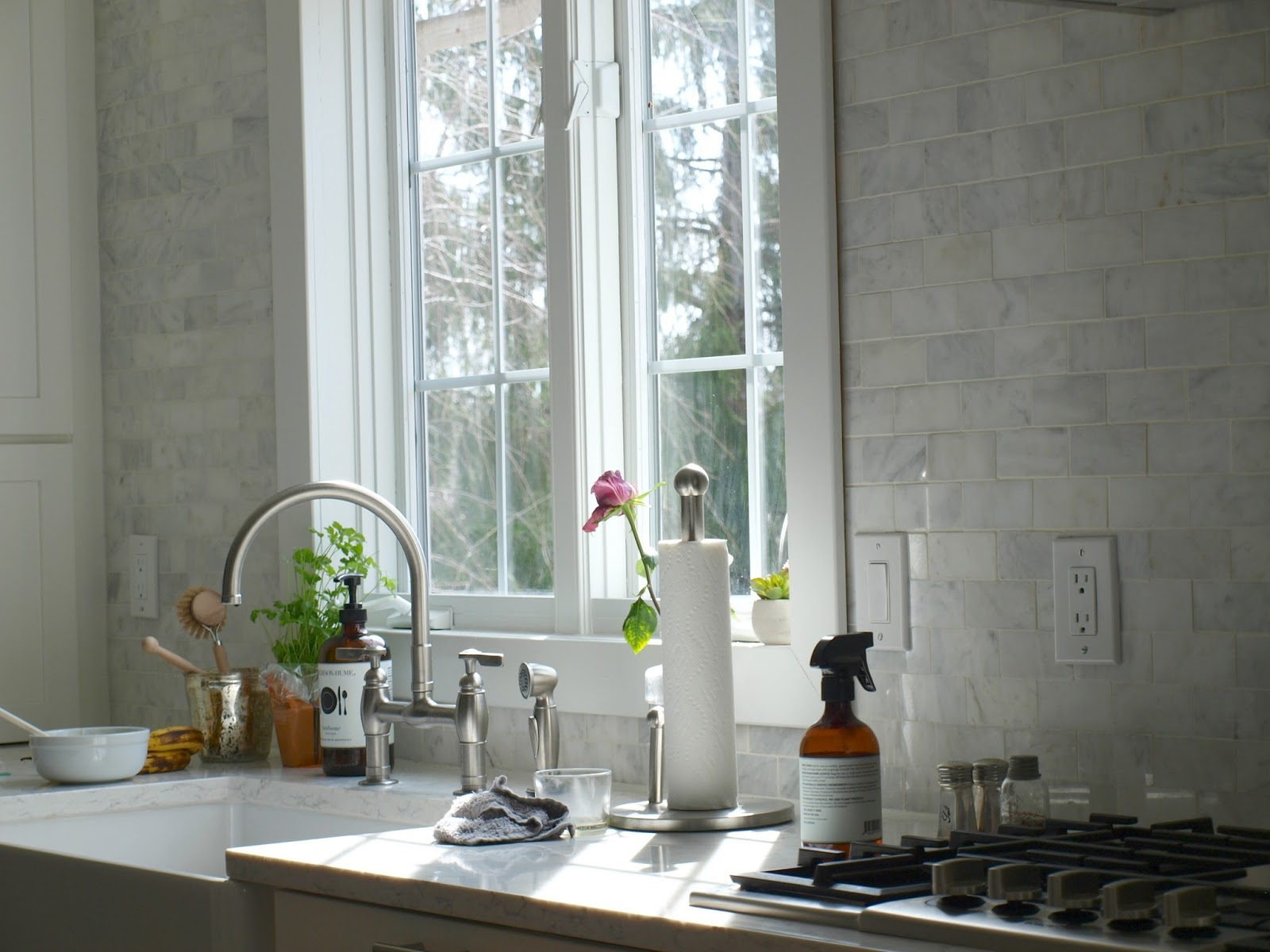 Hello Lovely Studio fixer upper kitchen with marble subway tile wall