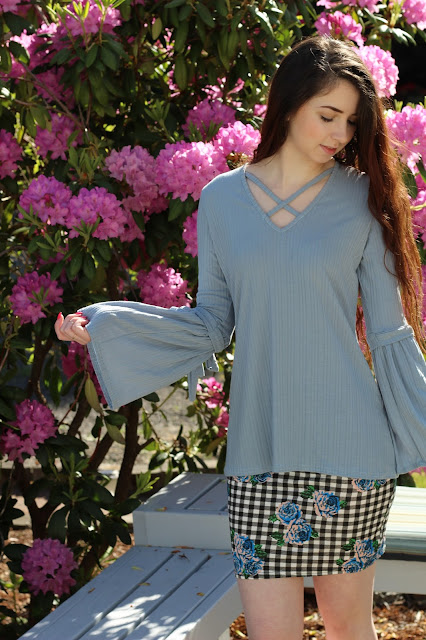 light blue crisscross bell sleeve top from Boohoo