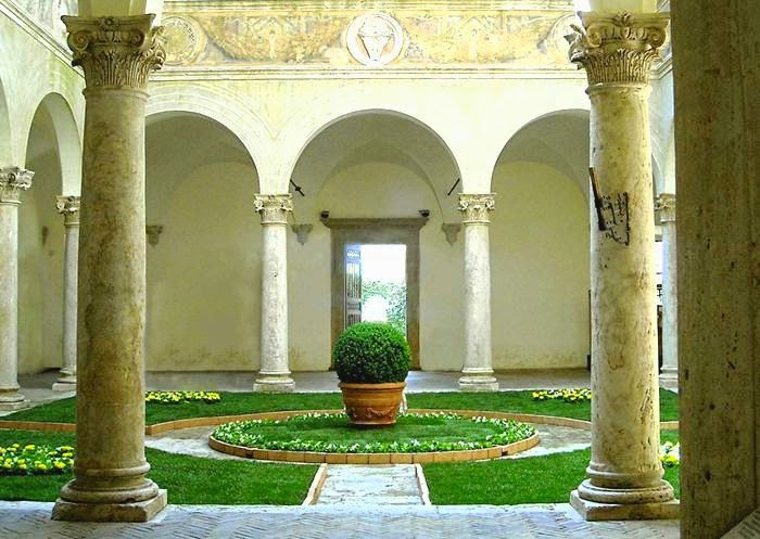 Courtyard of the Palazzo Piccolomini decorated in classic garden stlle.