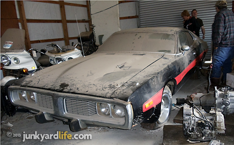 Front view of black 1973 Dodge Charger 440 Rallye package showing grille and bumperettes on junkyardlife.com