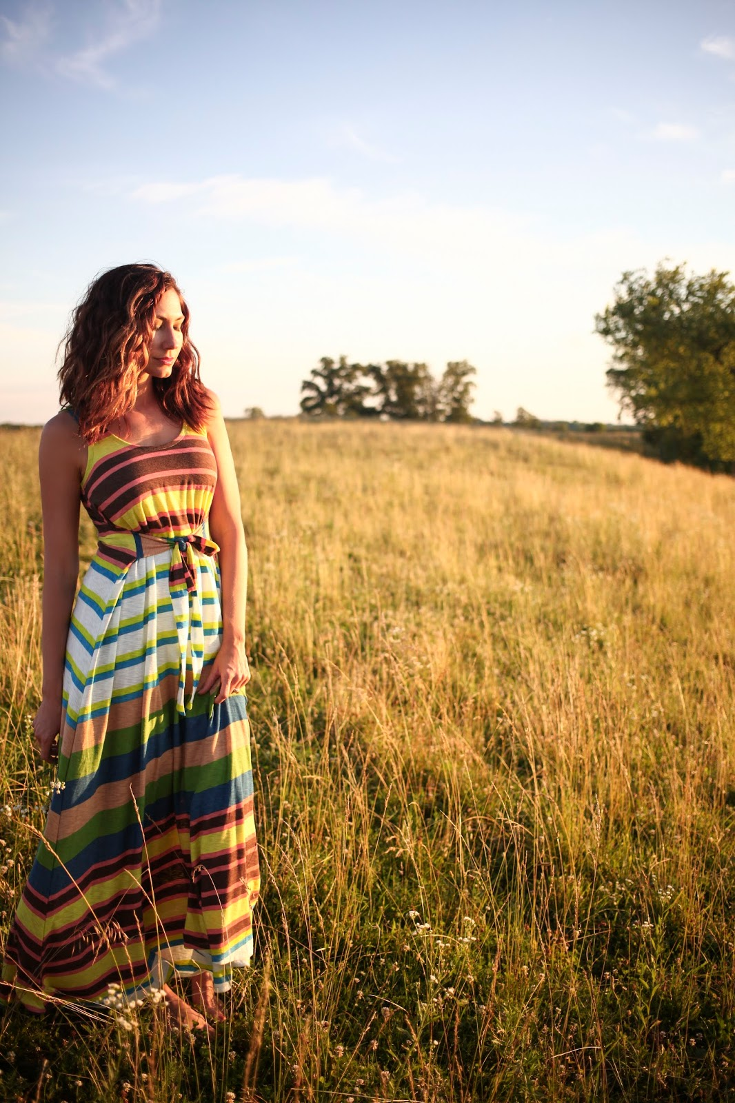 Amy West wearing multi colored striped maxi dress