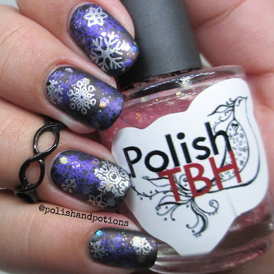 Silver and metallic purple snowflakes over black and glitter