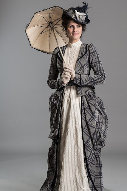 Women's Victorian Era Clothing. This costume is a day dress in white with plaid overcoat. Hat, gloves and parasol. Women's Steampunk costumes and clothing.