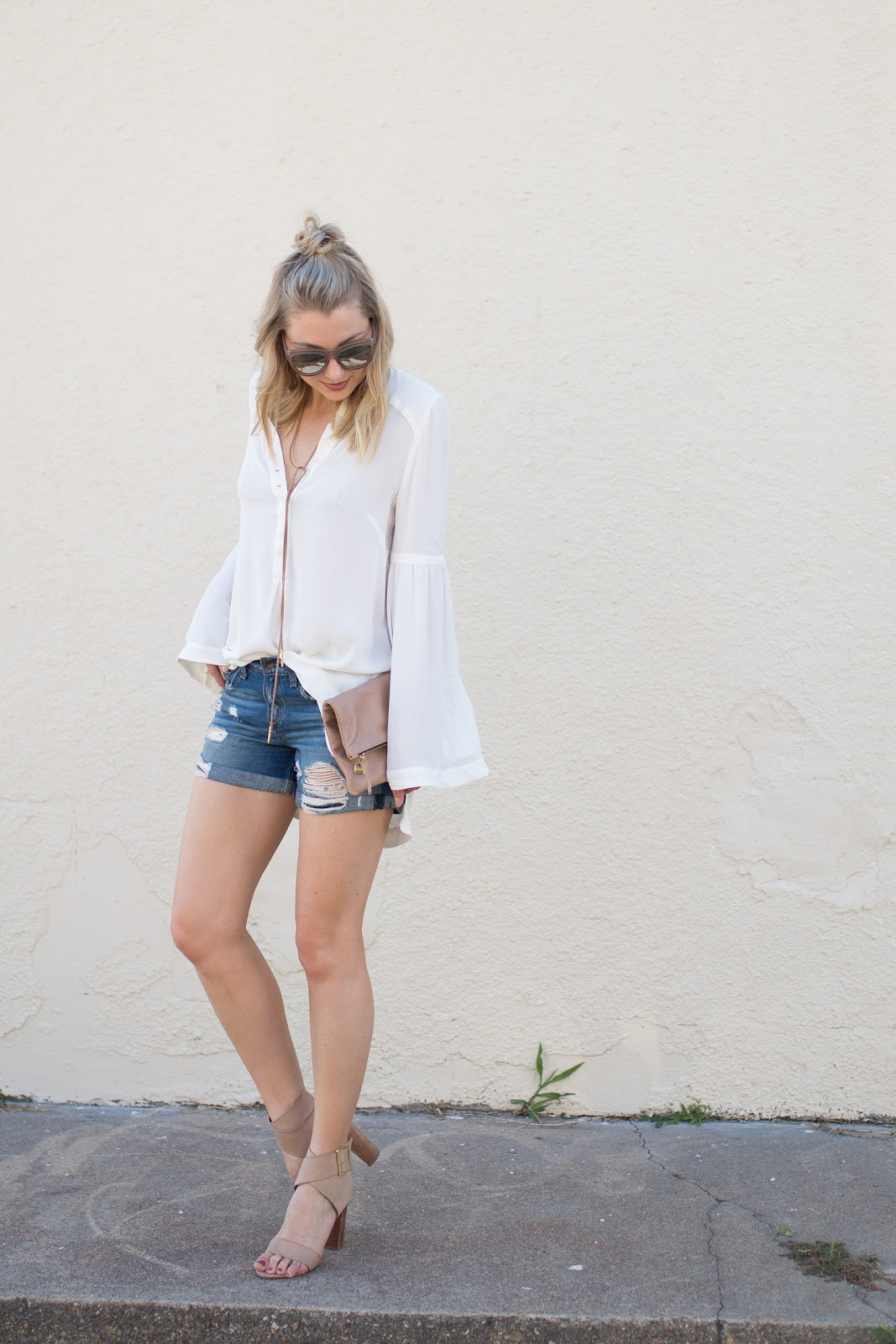 Distressed jean shorts with a white top