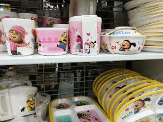 a bunch of minion products including mugs and plates