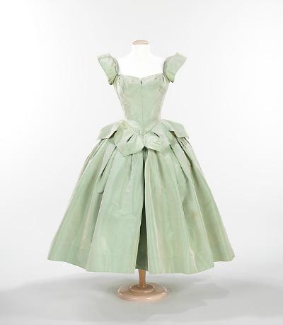 Pale celery green dress in shape of flower petal by Charles James displayed on dress form