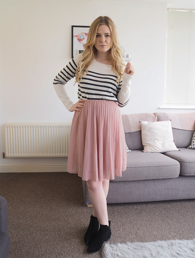pink pleated midi skirt with stripey jumper
