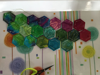 Attaching the multi-coloured hexies