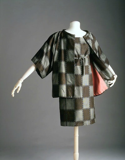 Grey and black cocktail dress and coat by Bonnie Cashin displayed on mannequin