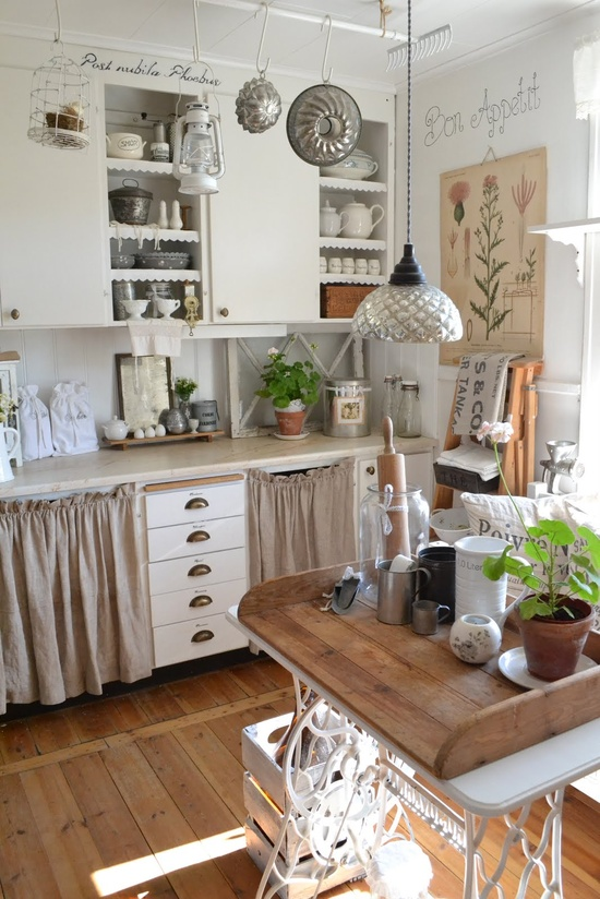 Vintage tin accessories and wooden  textures make this country style kitchen a lovely place to hide out and cook