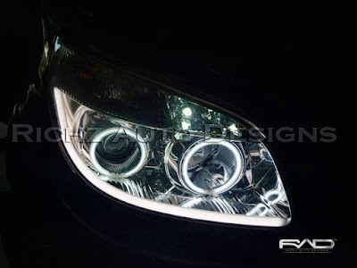 custom angel eyes dan audiline pada headlamp toyota rush 2009