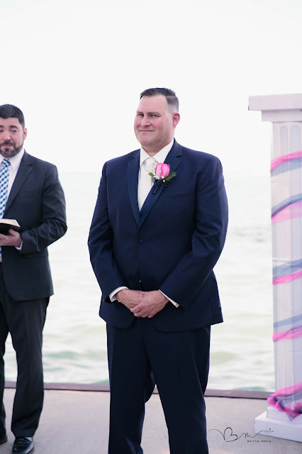 groom crying during ceremony at  new baltimore waterfront wedding