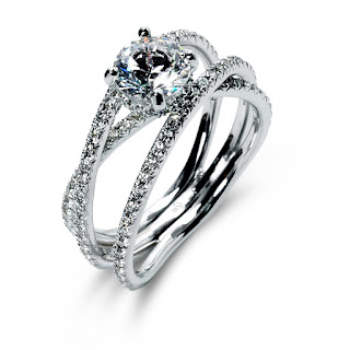 Cord Of Three Strands United Creates A Lively And Memorable Engagement Ring The Split Shank Crossover Design Features Four Pink White Diamond