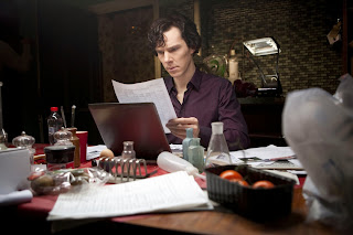 Benedict Cumberbatch as Sherlock Holmes in his purple shirt in Season 1 Episode 3 The Great Game