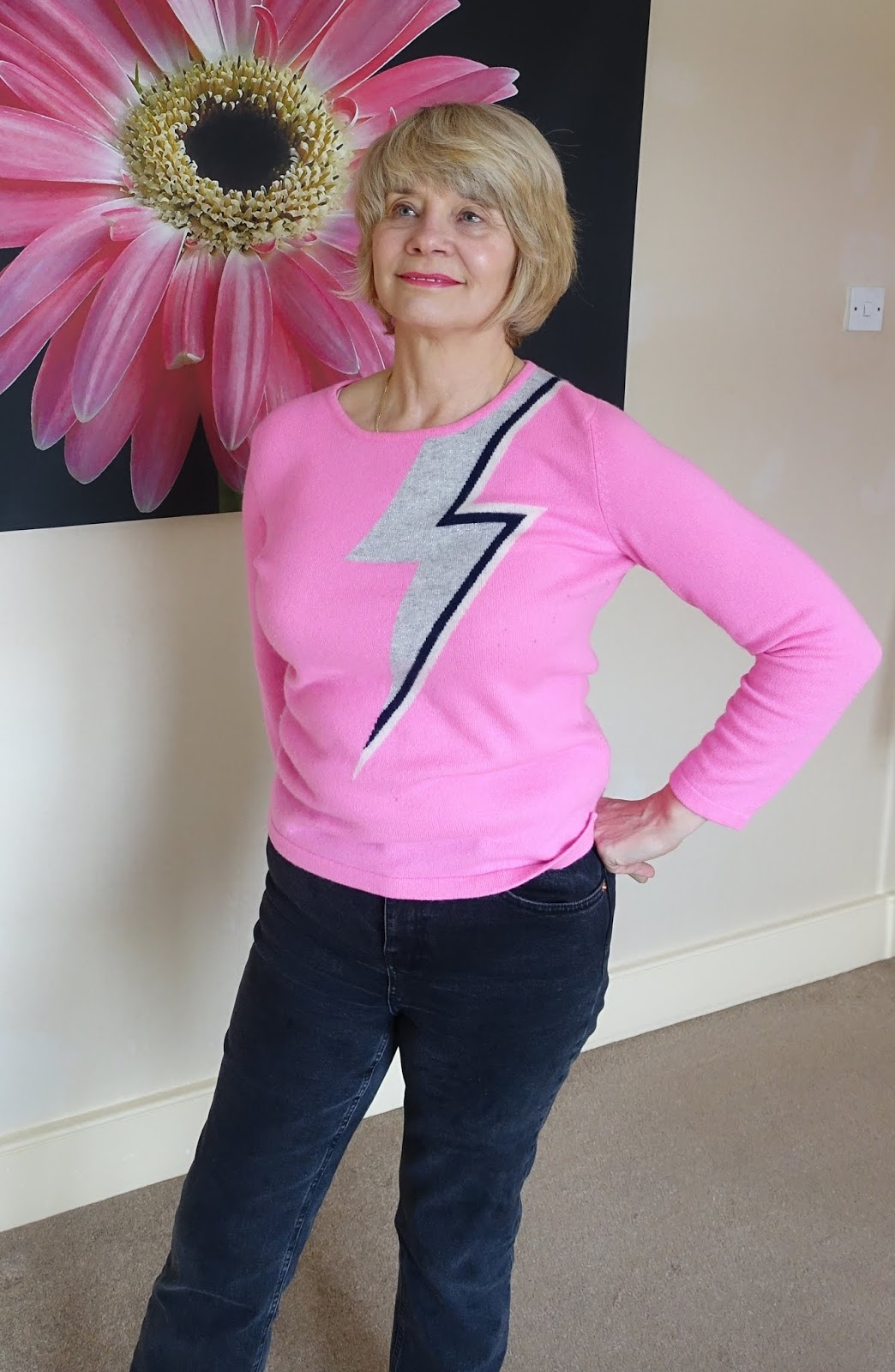 Mid life woman wearing a pink Bowie flash cashmere jumper from Orwell and Austen
