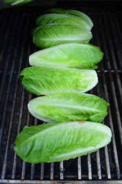 Romaine Hearts cut in half on barbecue grate for Grilled Romaine.
