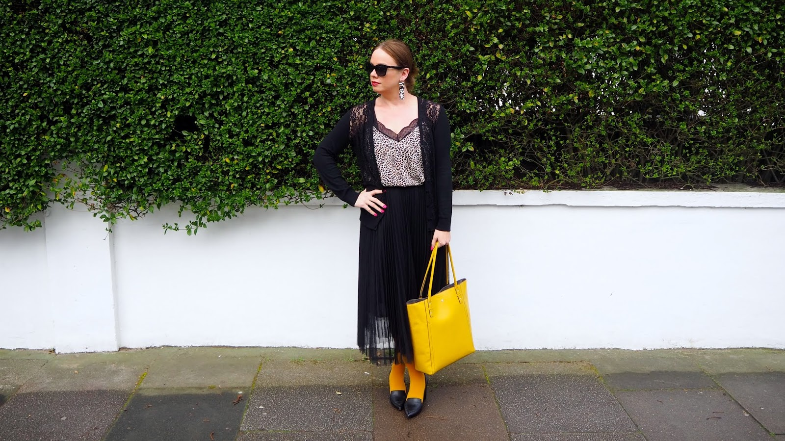 Leopard top, lace cardigan, black pleated mesh tulle midi skirt, mustard yellow tights, black shoes and mustard bag