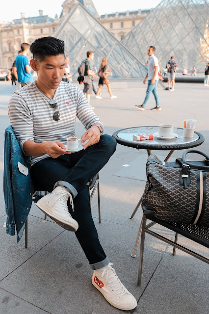 Leo Chan outside of the Louvre Museum in Paris wearing Comme des Garcons
