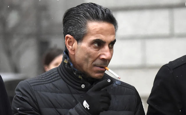 Joseph (Skinny Joey) Merlino, 55,smokes a cigarette