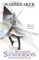 UK book cover of Warbreaker by Brandon Sanderson