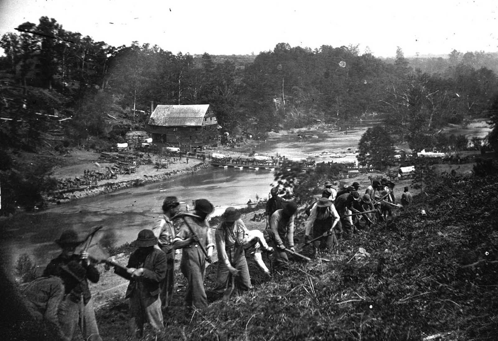 A party of the 50th New York Engineers builds a road on the south bank of the North Anna River, near Jericho Mills, Virginia, on May 24, 1864.