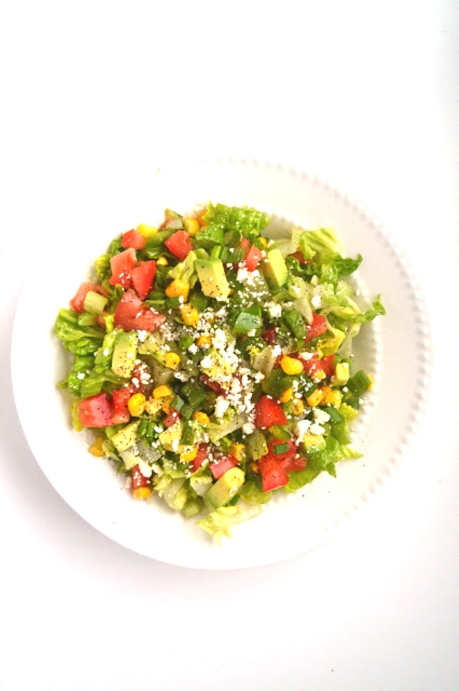 This Avocado, Corn and Feta Chopped Salad gives you a burst of each flavor in every bite! Ready in 5 minutes, it makes the perfect salad to accompany any meal! www.nutritionistreviews.com