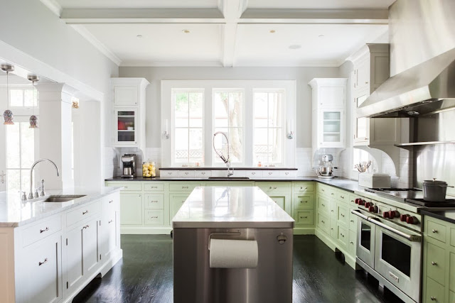 Modern farmhouse kitchen with industrial style and green cabinets on Hello Lovely Studio
