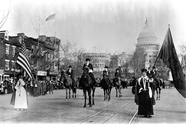 Women suffragists at the head of the parade, marching down Pennsylvania Avenue, with the U.S. Capitol in background, on March 3, 1913.