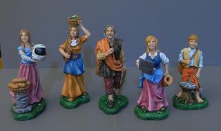 statuette presepio personalizzate ritratto famiglia genitori figli orme magiche
