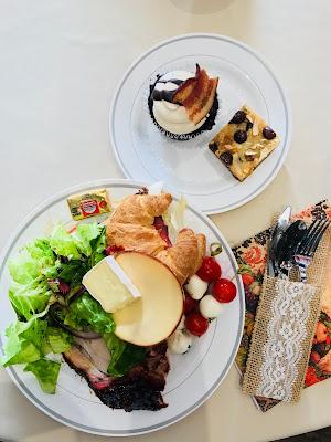 Photo of roasted pork, gouda salad, caprese, cupcakes and dessert