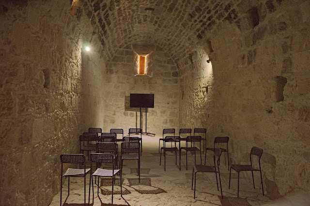 The last floor of the castle includes a small room with screen for displaying information, in Kolossi, Cyprus.
